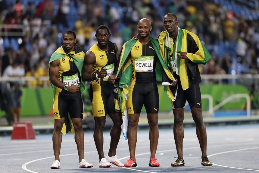 The Jamaican relay team celebrate their win in the men's 4x100.
