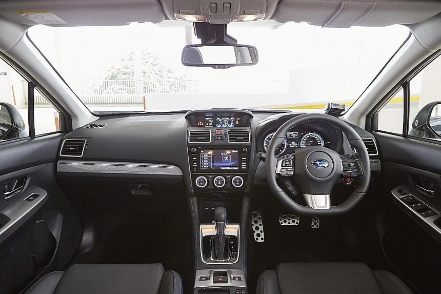 The 1.6-litre Subaru Levorg GT-S (far left) has a sporty cockpit (top), while the 1.4-litre Volkswagen Golf Variant R-Line (left) has a dashboard (above) that is equipped with intuitive infotainment controls.