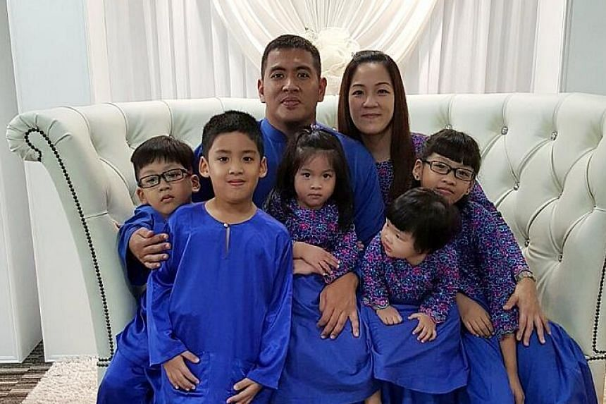 Mr Mirza with his wife Eileen and their children (from left) Ermann, Ezatt, Nur Ezelle, Nur Ezabelle and Nur Ezanne.
