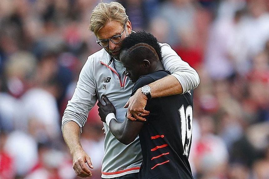 Liverpool manager Jurgen Klopp celebrating with Sadio Mane after the 4-3 victory over Arsenal in their English Premier League opener last Sunday.