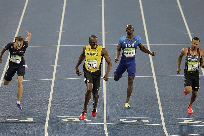 Above: Usain Bolt winning the 200m final in 19.78sec, ahead of Andre de Grasse (right) and Christophe Lemaitre (left). LaShawn Merritt came in sixth. Left: Ever the showman, Bolt will run his final Olympic race this morning in the 4x100m relay.