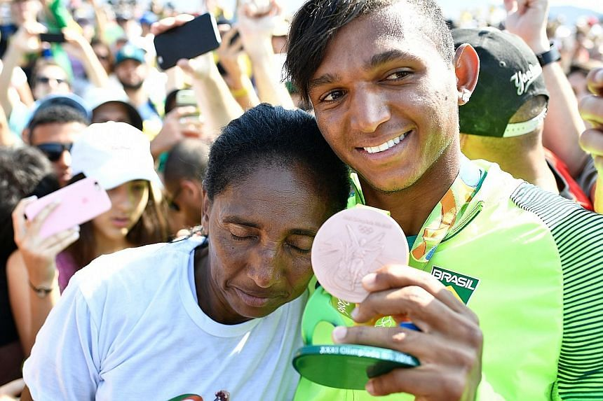 A joyous Isaquias Queiroz dos Santos with his mother Dona Dilma Queiroz after taking bronze in the C1 200m final at the Lagoa Stadium. He earlier won a silver in the C1 1,000m and is going for gold today with Erlon de Souza Silva in the C2 1,000m, in