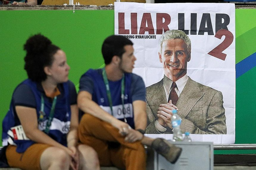 A poster at the Olympic Stadium in Rio superimposing the head of US swimmer Ryan Lochte on the body of actor Jim Carrey, in a mock-up based on publicity material from the 1997 film Liar Liar, about a lawyer who is prevented from lying for 24 hours.