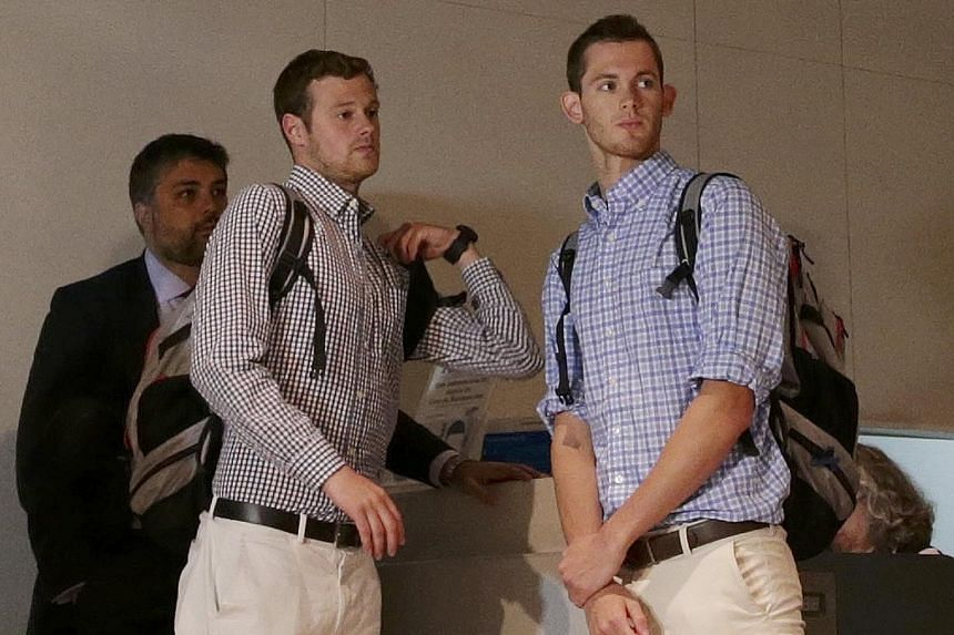 Jack Conger (left) and Gunnar Bentz prepare to board a flight back home on Thursday, after being interrogated by police in Rio de Janeiro.