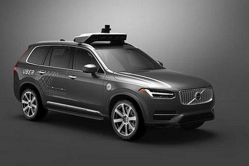 A modified self-driving Volvo SUV that Uber plans to put on the roads of Pittsburgh. It will be the first attempt to commercialise autonomous vehicles. A driver testing a Tesla Model S sedan's Autopilot feature last year. Major car companies have inv