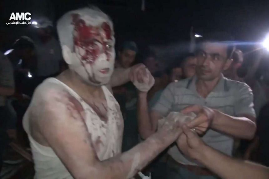 An injured man is rescued after an alleged airstrike hits a house in Aleppo on Aug 17, 2016, in a photo provided by the pro-opposition activist group Aleppo Media Centre.
