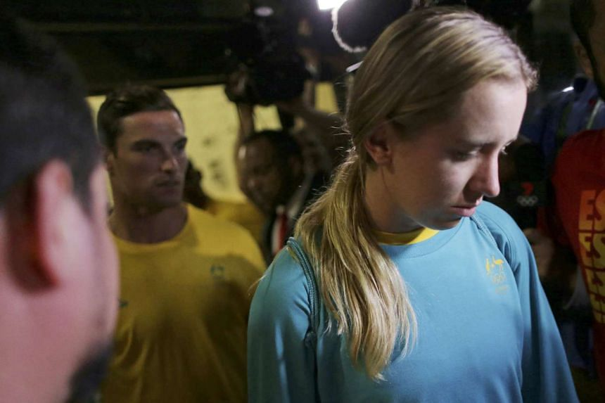 Olympic athletes from Australia leave a police station after being questioned by Brazilian police for entering the basketball arena without proper accreditation.
