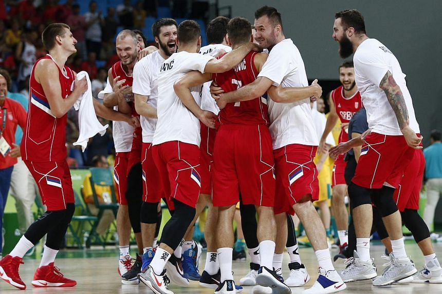 Serbian players celebrate their win after the men's Basketball semi-final game between Australia and Serbia.