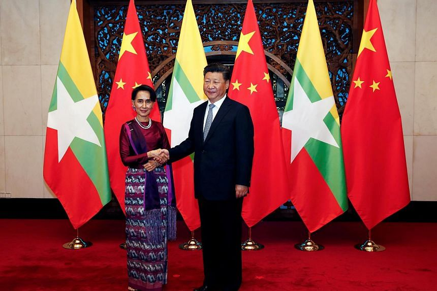 Myanmar State Counsellor Aung San Suu Kyi (left) and Chinese Premier Xi Jinping (right) posing for the media before a meeting at the Diaoyutai State Guesthouse in Beijing, China, on August 19.
