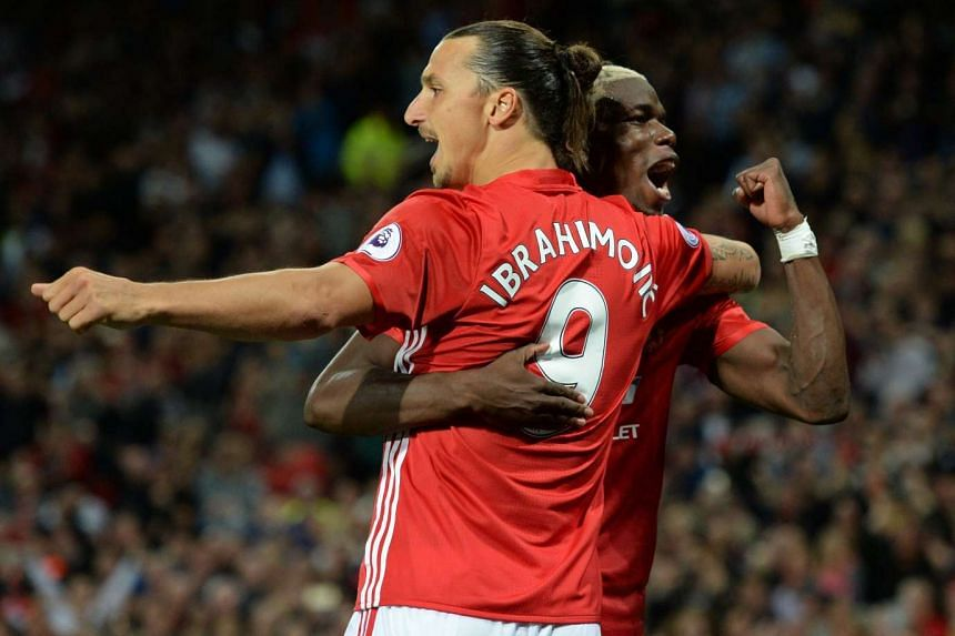 Manchester United's Swedish striker Zlatan Ibrahimovic (left) celebrates with French midfielder Paul Pogba after scoring their second goal.