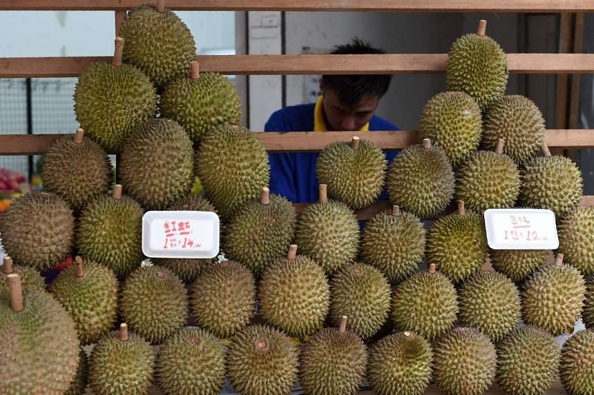 The suspect allegedly grabbed a knife from the durian stall and tried to attack the seller.