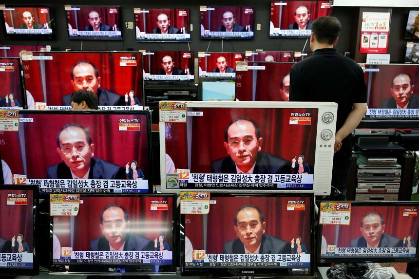 Television sets broadcasting a report on North Korea's deputy ambassador in London Thae Yong Ho, who has defected with his family.