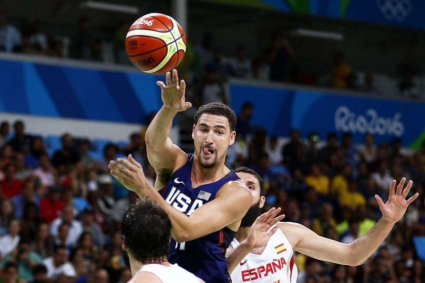 Klay Thompson (centre) of the US in action during the men's basketball semi final against Spain.