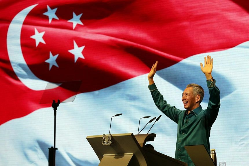 Prime Minister Lee Hsien Loong' waves to the audience after delivering his National Day Rally speech at ITE Central in Ang Mo Kio on August 17, 2014.
