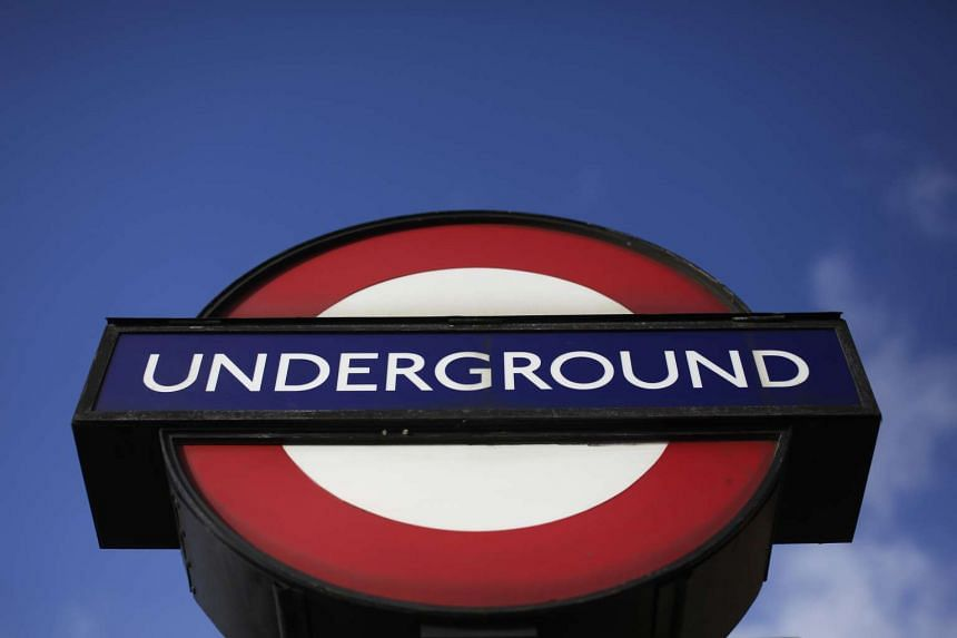 A London Underground logo sits on a sign outside the Redbridge subway station in 2014.