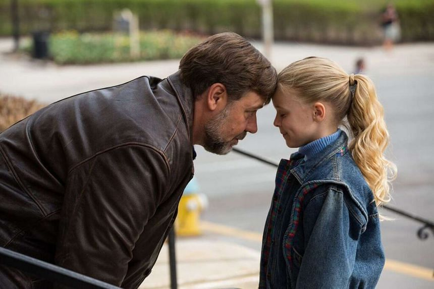 Fathers and Daughters, starring Russell Crowe (left) and Kylie Rogers (right).