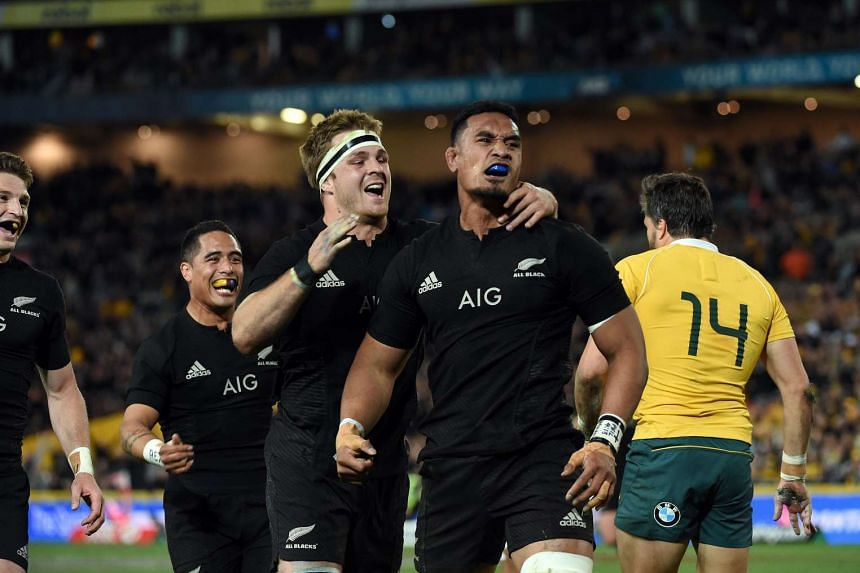 New Zealand players celebrate a successful try against Australia.