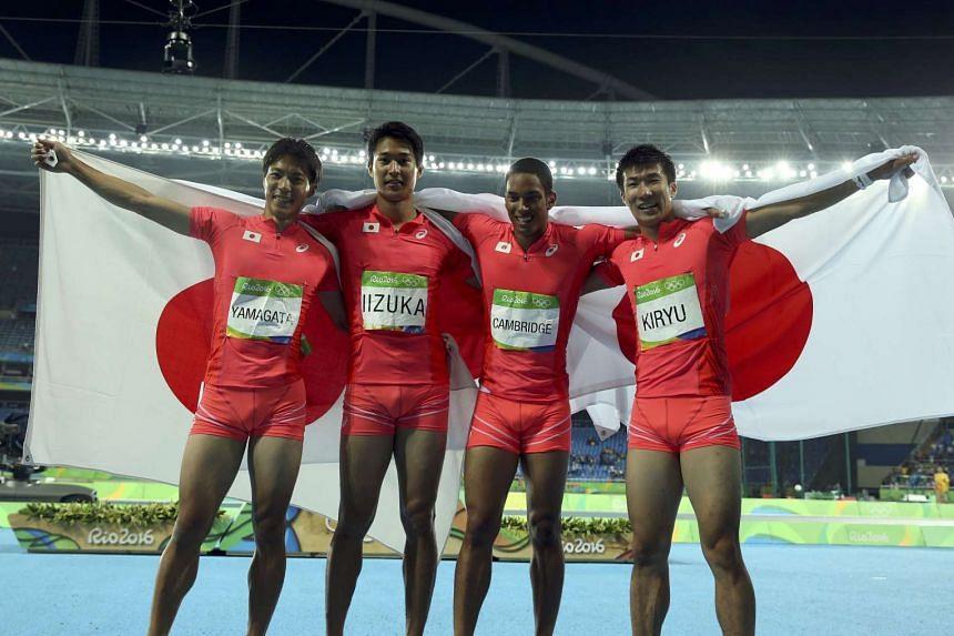 Japanese sprinters (from left) Ryota Yamagata, Shota Iizuka, Aska Cambridge and Yoshihide Kiryu celebrate winning the silver medal.