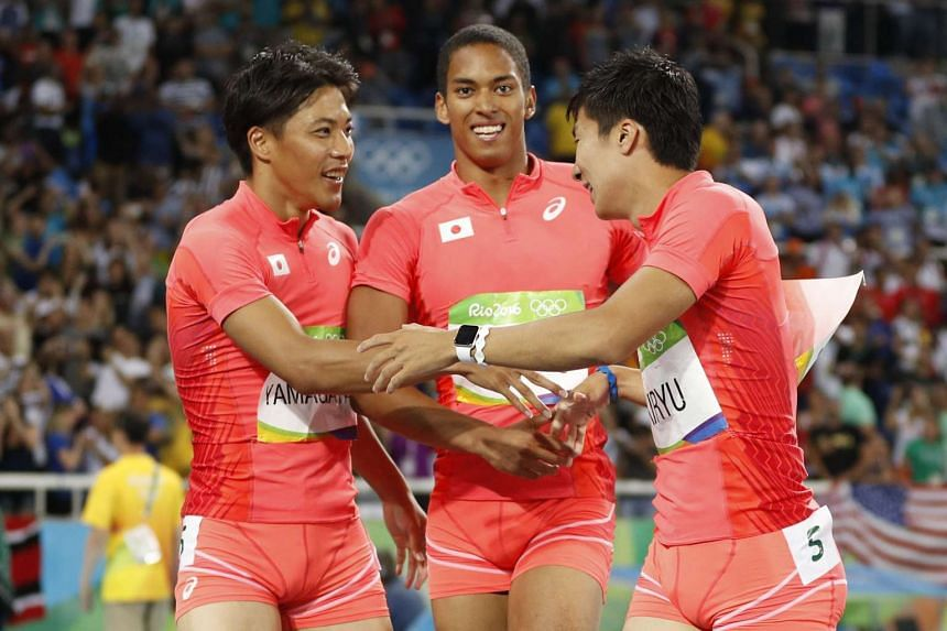 Japanese sprinters (from left) Ryota Yamagata, Aska Cambridge and Yoshihide Kiryu, celebrate after finishing second in the men's 4x100m relay final.