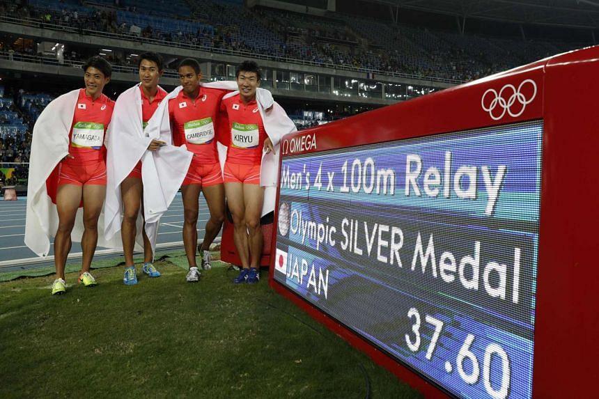 Japanese sprinters (from left) Ryota Yamagata, Shota Iizuka, Aska Cambridge and Yoshihide Kiryu celebrate after finishing second in the men's 4x100m relay final.