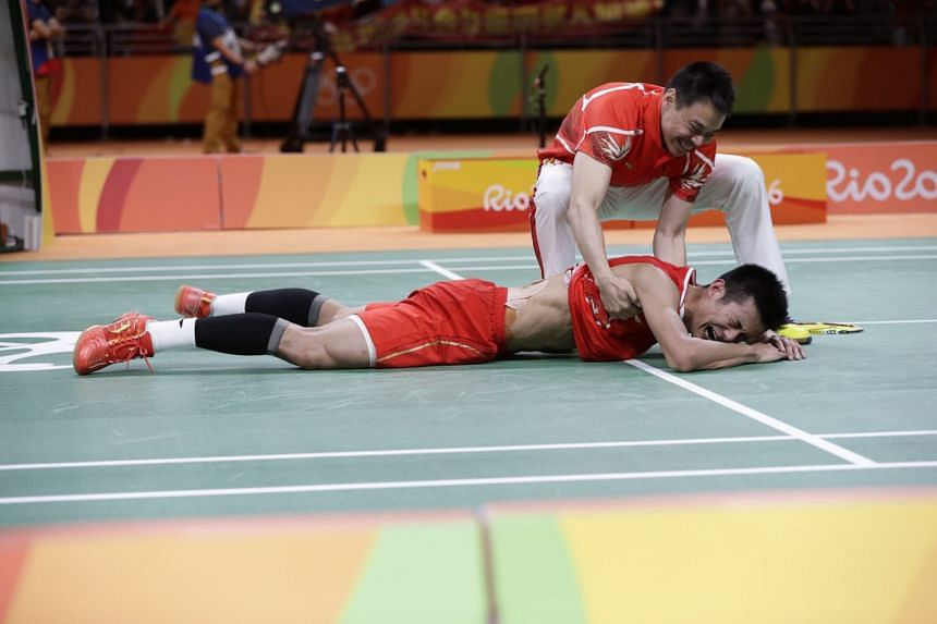 China's Chen Long is overcome with emotion after clinching gold.