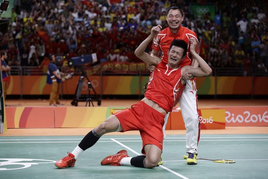 China's Chen Long is overcome by emotion after winning the gold medal.