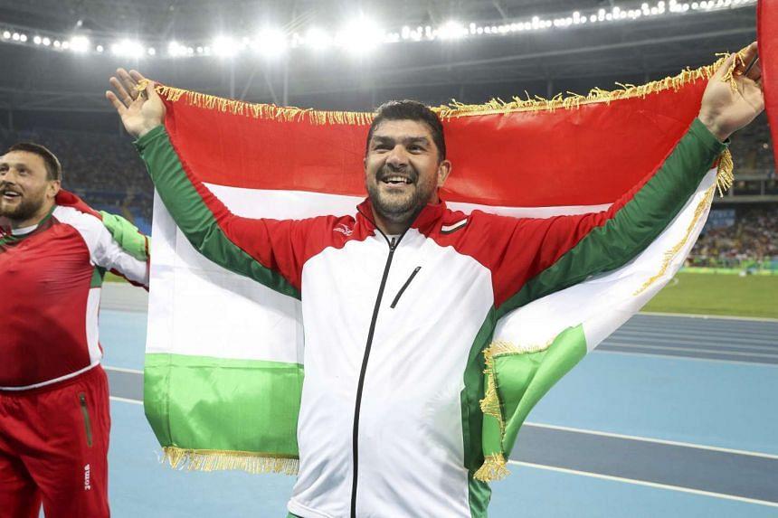 Dilshod Nazarov of Tajikistan celebrates after winning the men's Hammer Throw final on August 19.