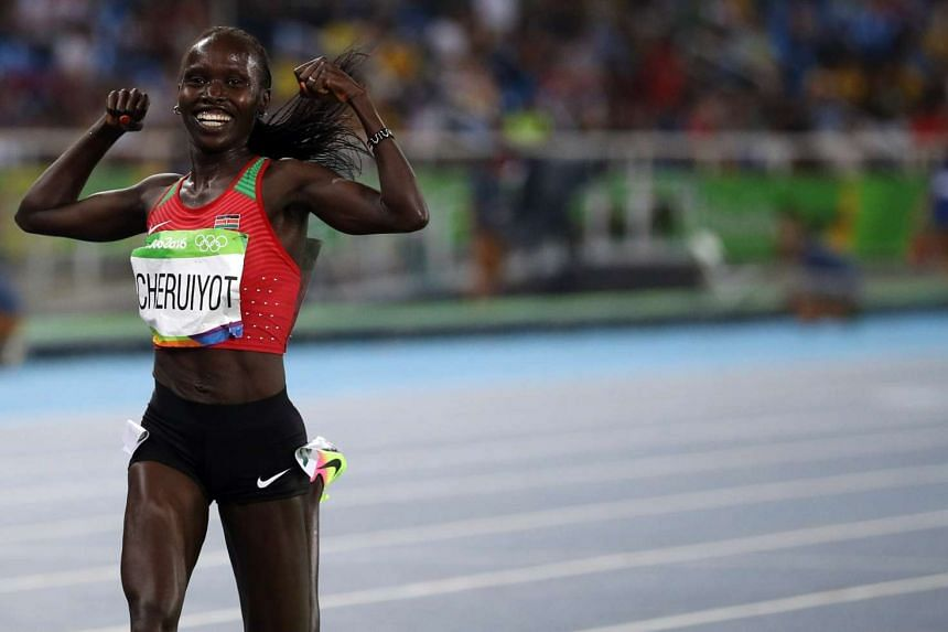 Vivian Cheruiyot of Kenya celebrates after winning gold in the women's 5000m final.