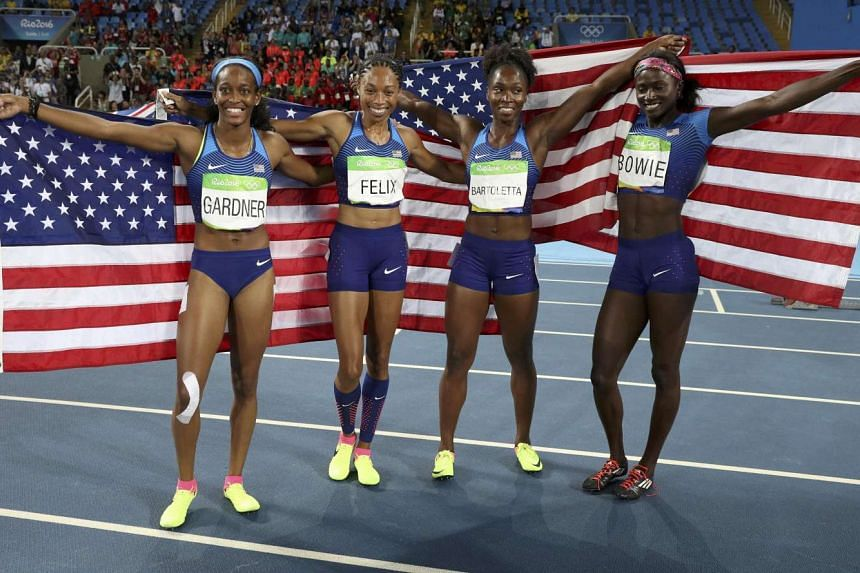 (Left to right) Tori Bowie, Tianna Bartoletta, English Gardner and Allyson Felix of the US celebrate winning the gold medal for the women's 4 x 100m relay final.