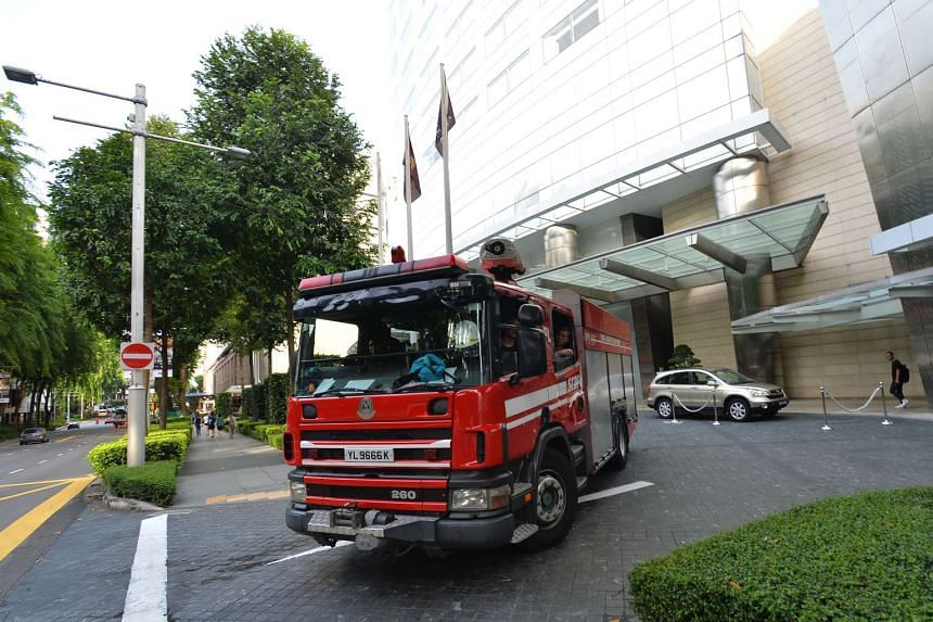 An SCDF vehicle leaving The St Regis Singapore at 5.56pm on Aug 21, 2016.