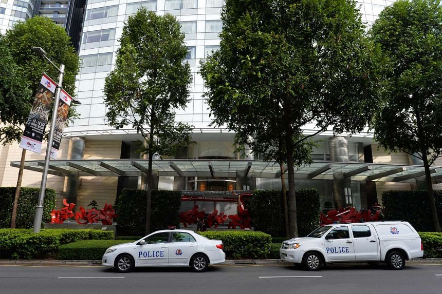 SCDF and police vehicles outside St Regis Singapore along Tanglin Road around 5.24pm on Aug 21, 2016.