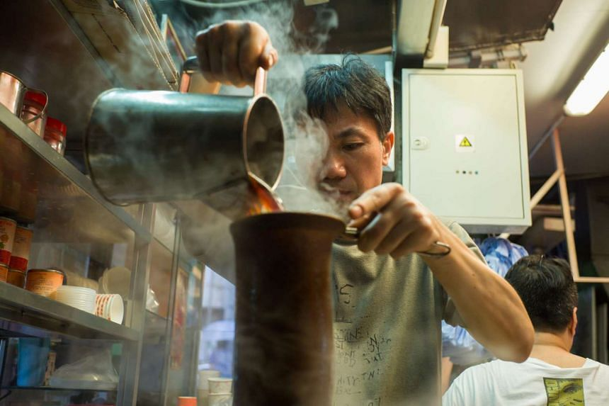 A tea master makes milk tea at family-run tea shop in Hong Kong on Aug 10, 2016.