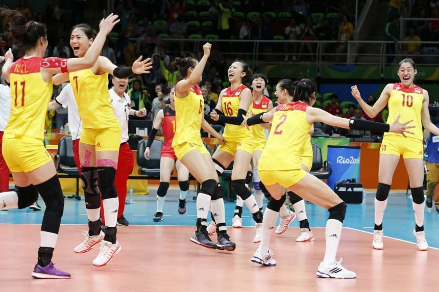 The Chinese team celebrates winning the women's Volleyball Gold Medal match against Serbia on Aug 20, 2016.