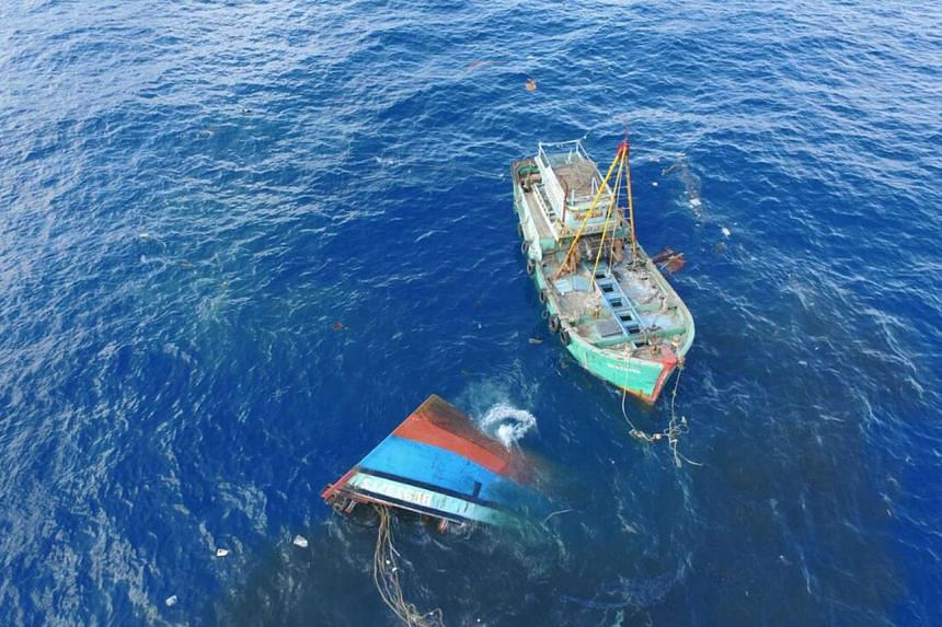This handout photo taken on Aug 17, 2016 by the Indonesian Marine Affairs and Fisheries Ministry and released on Aug 18 shows illegal fishing boats being sunk in the Natuna sea off the coast of Indonesia.