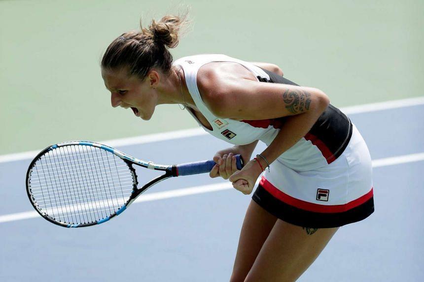 Pliskova celebrates her win.