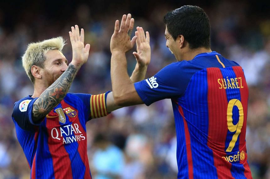 Suarez (right) celebrates with Messi after scoring.
