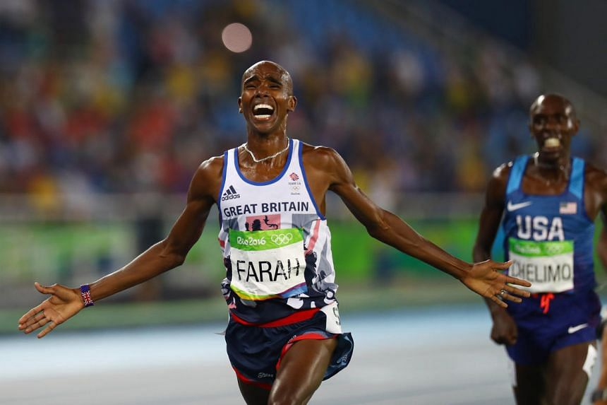 Mo Farah of Britain celebrates after winning the gold medal for the men's 5000m final on Aug 20.