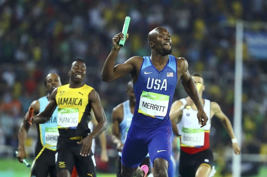 LaShawn Merritt of USA crosses the finish line to win team USA the gold on Aug 20.
