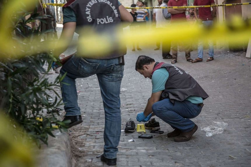 Turkish police working near the explosion scene following a late night attack on a wedding party that left at least 30 dead in Gaziantep in southeastern Turkey near the Syrian border on Aug 21, 2016. Turkish President Recep Tayyip Erdogan on Sunday s