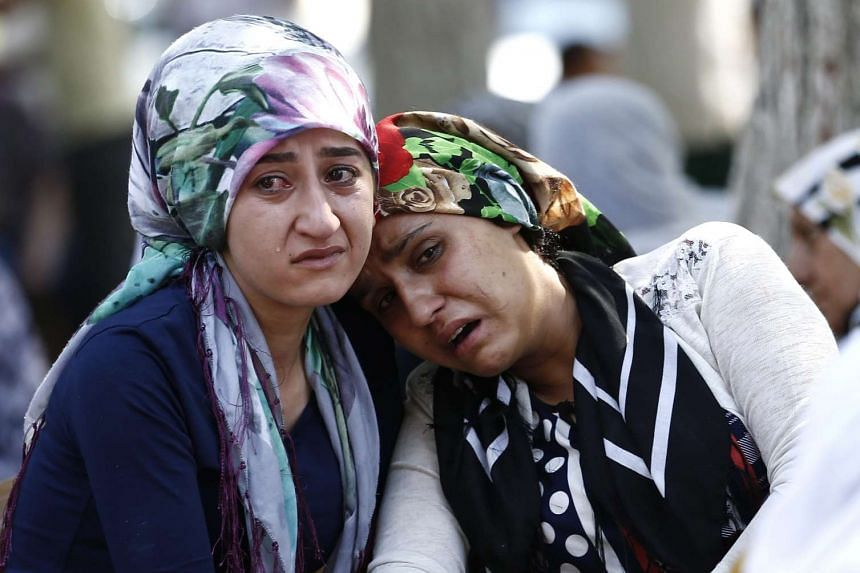 Relatives of victims killed in a bomb attack on a pre-wedding party mourning in front of the forensic medicine institute in Gaziantep, in the southeast of Turkey, on Aug 21, 2016. At least 30 people were killed in a suicide attack late Aug 20 during