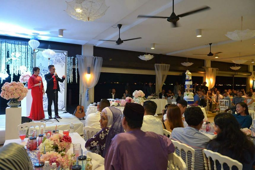Singapore Idol 3 winner Sezairi Sezali and his wife on stage during their wedding dinner on Sunday (Aug 21) at the SAF Yacht Club.