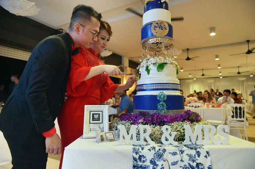 Singapore Idol 3 winner Sezairi Sezali looks on as his wife cuts the cake during their wedding dinner on Sunday (Aug 21) at the SAF Yacht Club.