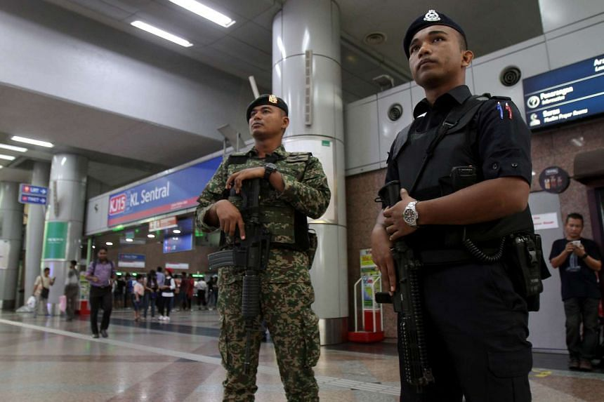 Policemen on duty at  KL Sentral and NU Sentral in Kuala Lumpur.