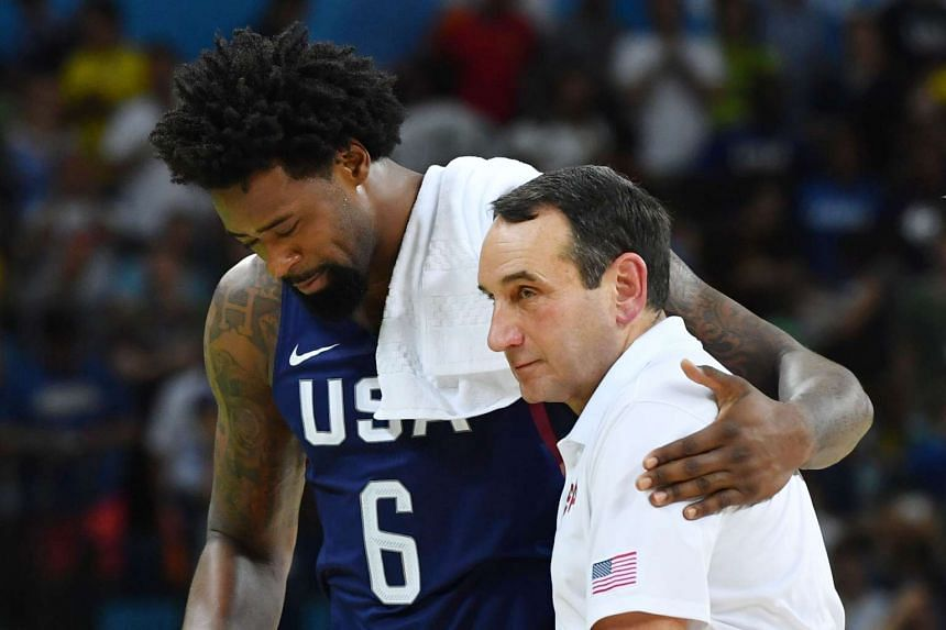 DeAndre Jordan (left) celebrates with head coach Mike Krzyzewski after winning a Men's semifinal basketball match between Spain and US on Aug 19, 2016.