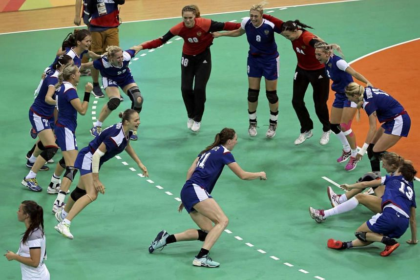The Russian team in women's handball celebrate their victory and first Olympic gold medal in women's handball on Aug 21, 2016.