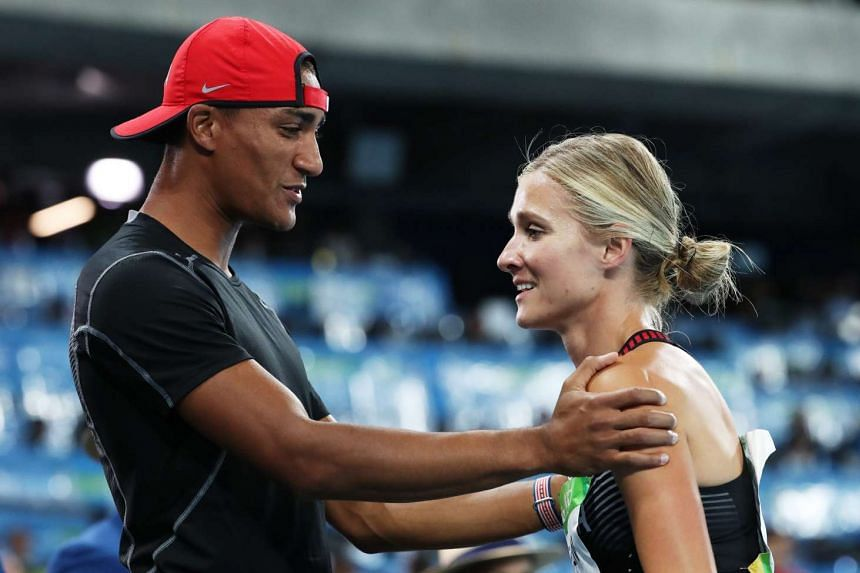 Brianne Theisen Eaton is congratulated by her husband and US decathlete Ashton Eaton after placing third in the Heptathlon event on Aug 13, 2016.