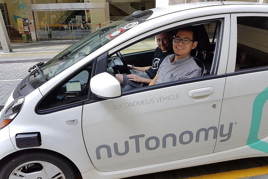 Sunday Times reporter Zhaki Abdullah together with nuTonomy safety engineer Greg Butron in the start-up's self-driving Mitsubishi i-MiEV.