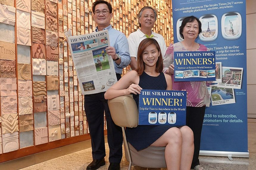 Ms Tan (seated) said she wanted to go to Iceland after she won. With her are three of the five winners of a two-day, one-night retreat sponsored by RWS (back row, from left) Mr Ng, Mr Kng Yong Wah, and Madam Tiang.