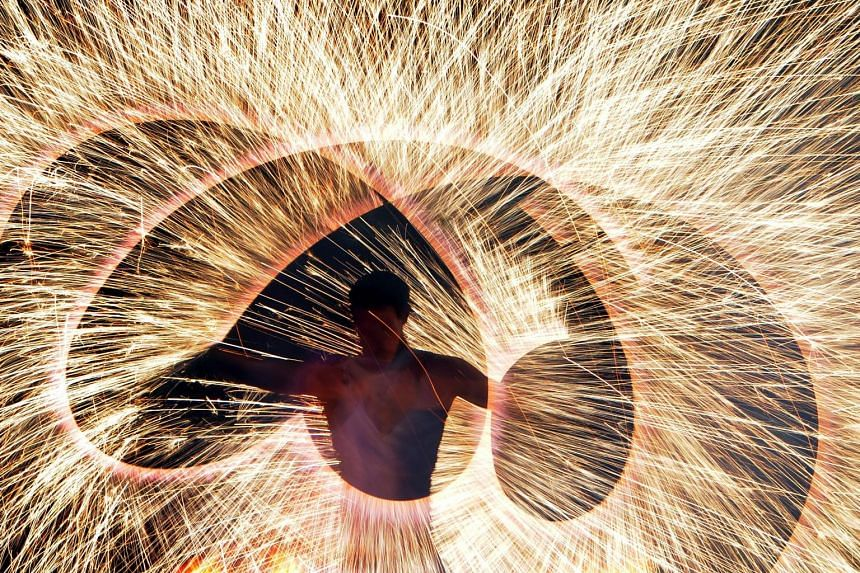 A fire artist performing at the Minsk International Fire Fest in Ratomka, near Minsk, on Friday. The annual festival, which takes place over two days, sees the world's best flame-throwers and pyrotechnic experts gather in the capital city of Belarus