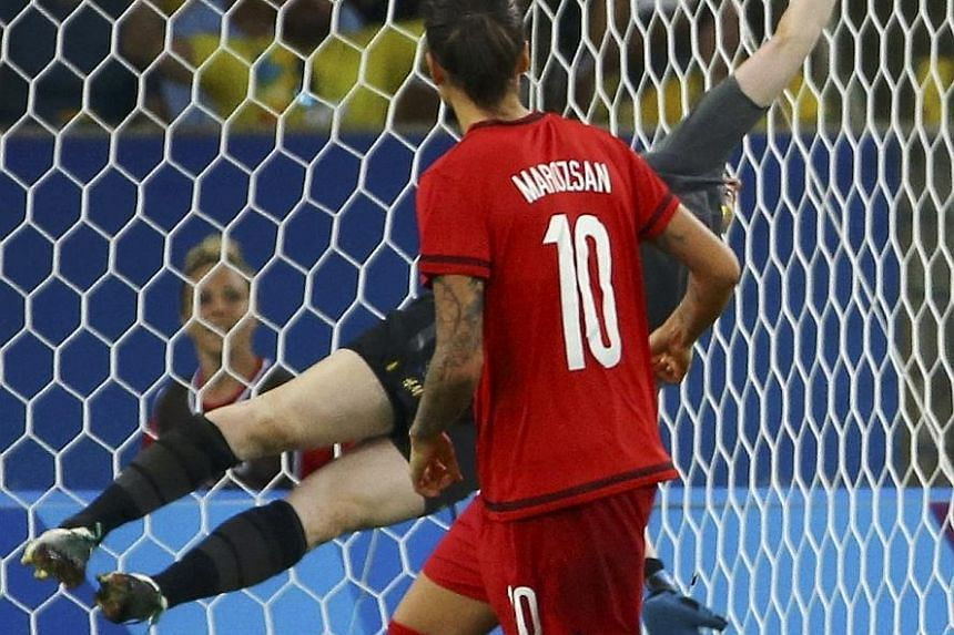 Germany's Dzsenifer Marozsan scoring her country's opening goal against Sweden in the women's football final. Germany won 2-1 for their first Olympic gold in the competition.